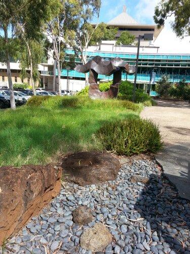 Pili grass grass, rock beds and naupaka